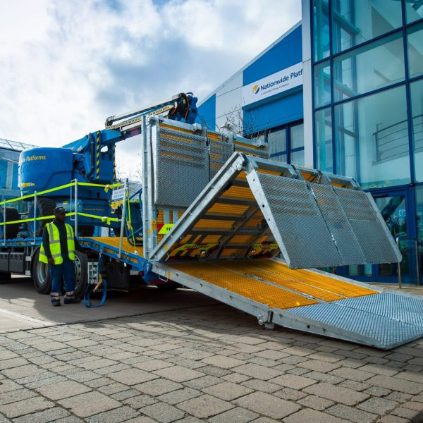 Sterling Nationwide Platforms double-flip beavertail truck in motion